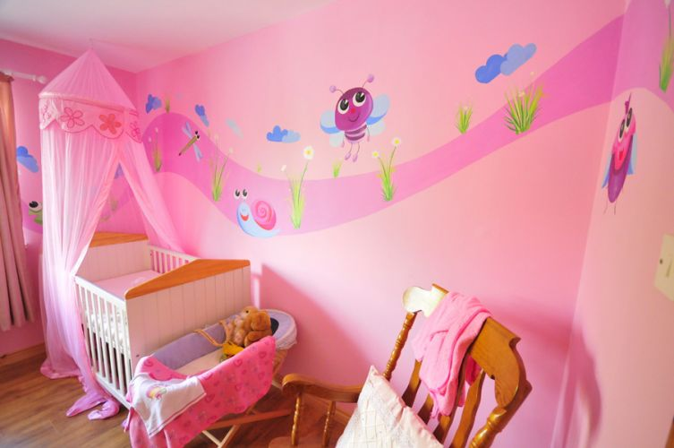 Elegant-modern-nursery-for-baby-girl-with-pink-walls-bed-with-pink-curtains-and-wood-chair